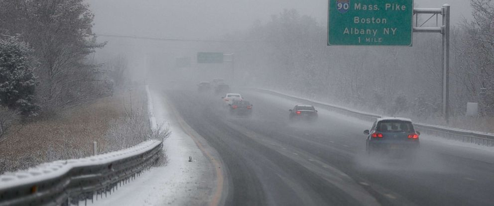 PHOTO: Vehicles drive in falling snow on Interstate 495 near the junction with Interstate 90 (The Massachusetts Turnpike) during the first snow storm of the season in Hopkinton, Mass., Dec. 9, 2017.