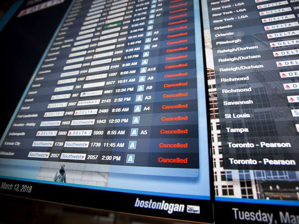 PHOTO: Information boards at Logan International Airport show hundreds of cancelled flights as a winter storm bears down, March 13, 2018, in Boston.