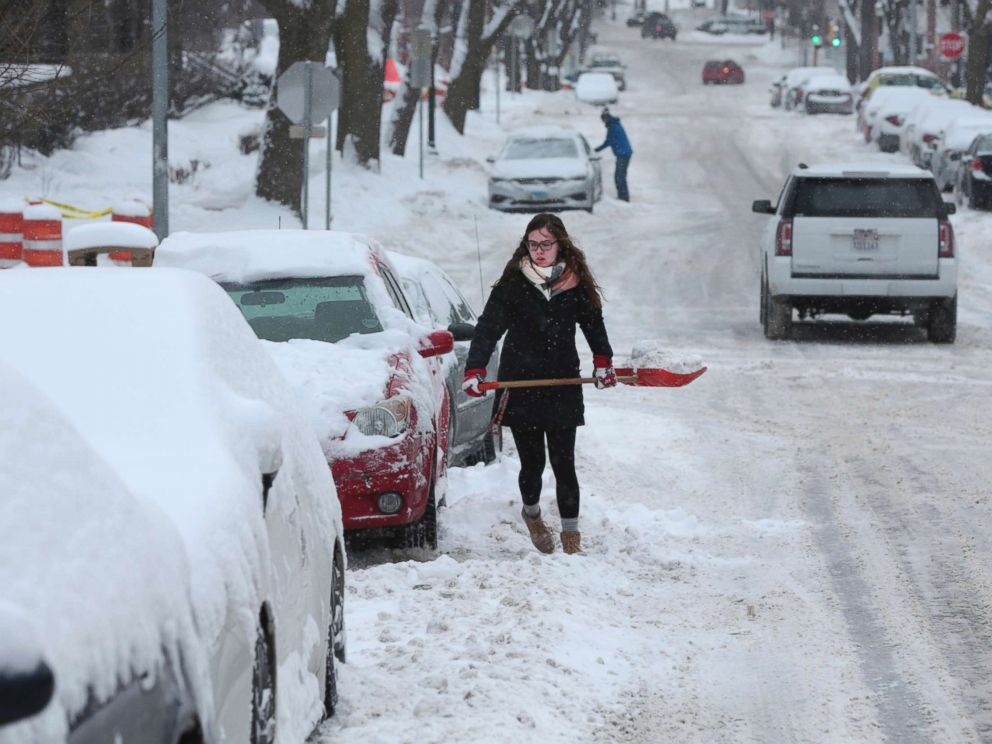 PHOTO: Morgan Leissring shovels out her car, Feb. 9, 2018 in Madison, Wis.