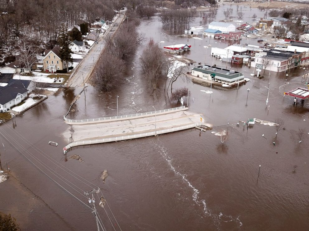 PHOTO: The swollen Pecatonica River spills into downtown Darlington, Wis., on Thursday March 14, 2019. The National Weather Service has issued a flood warning or flood watch for about two-thirds of the state.