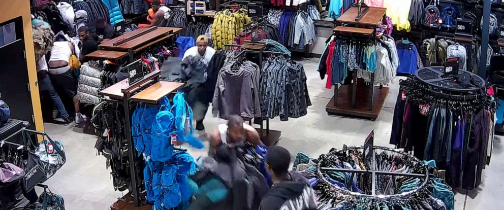 PHOTO: This image made from video shows a flash mob grabbing merchandise from a North Face store in Wisconsin this week.