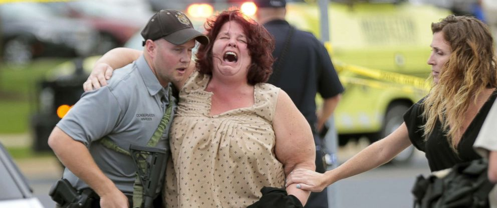 PHOTO: A woman is escorted from the scene of a shooting at a software company in Middleton, Wis., Sept. 19, 2018.