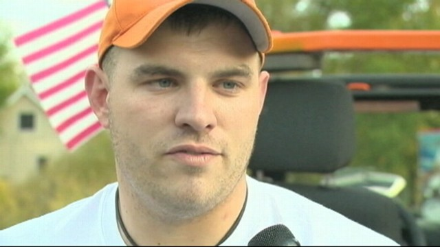 VIDEO: Staff Sgt. Travis Mills served as grand marshal in his Michigan hometowns parade.