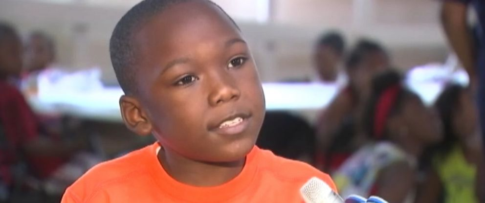PHOTO: TJ Donald, 8, of Chicago, talks to a reporter about gun violence.