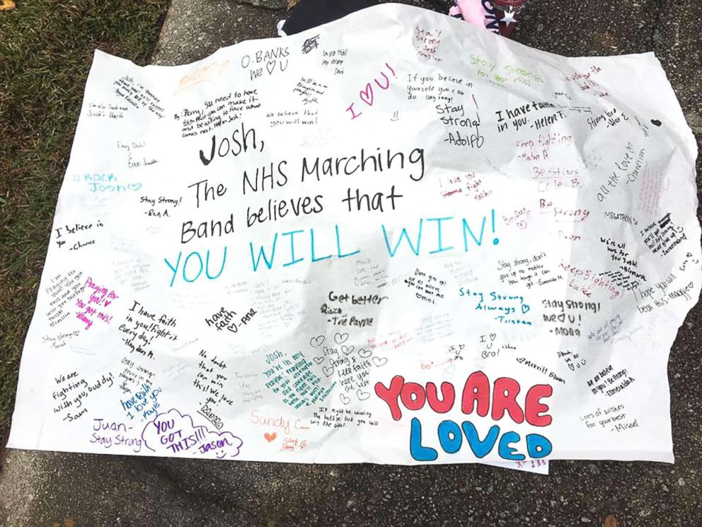 PHOTO: The Norcross High School marching band made a poster to carry as they marched to Josh Libmans house Thursday.