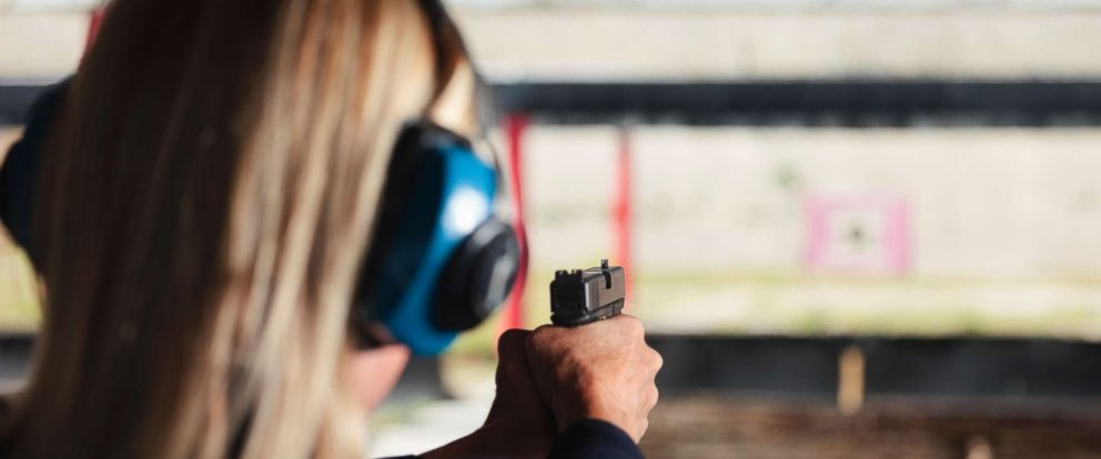 PHOTO: A woman at the shooting range aiming a gun in an undated stock photo.