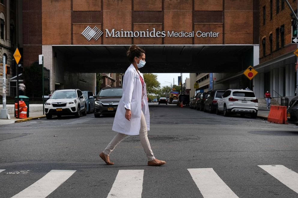 PHOTO: A medical worker walks by the Maimonides Medical Center in a neighborhood that saw a significant number of COVID-19 cases early on in the pandemic on Sept. 14, 2020, in the Brooklyn borough of New York City.