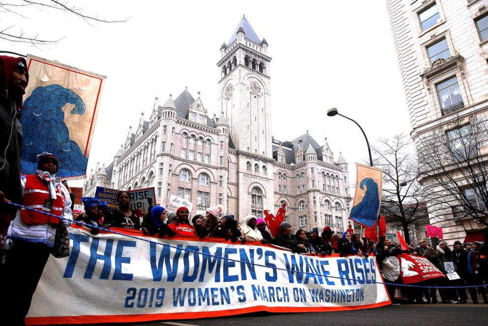 PHOTO: Demonstrators march past the Trump International Hotel during the third annual Womens March at Freedom Plaza in Washington, Jan. 19, 2019.