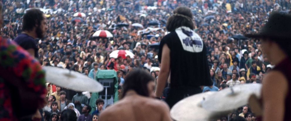 PHOTO: Country Joe & The Fish perform in the rain at at the Woodstock Music and Arts Fair in Bethel, New York, August 17 1969.