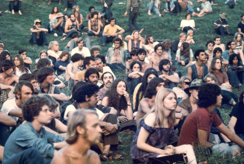 PHOTO: Audience members watch a performance at the Woodstock Music and Arts Fair in Bethel, New York, August 1969.