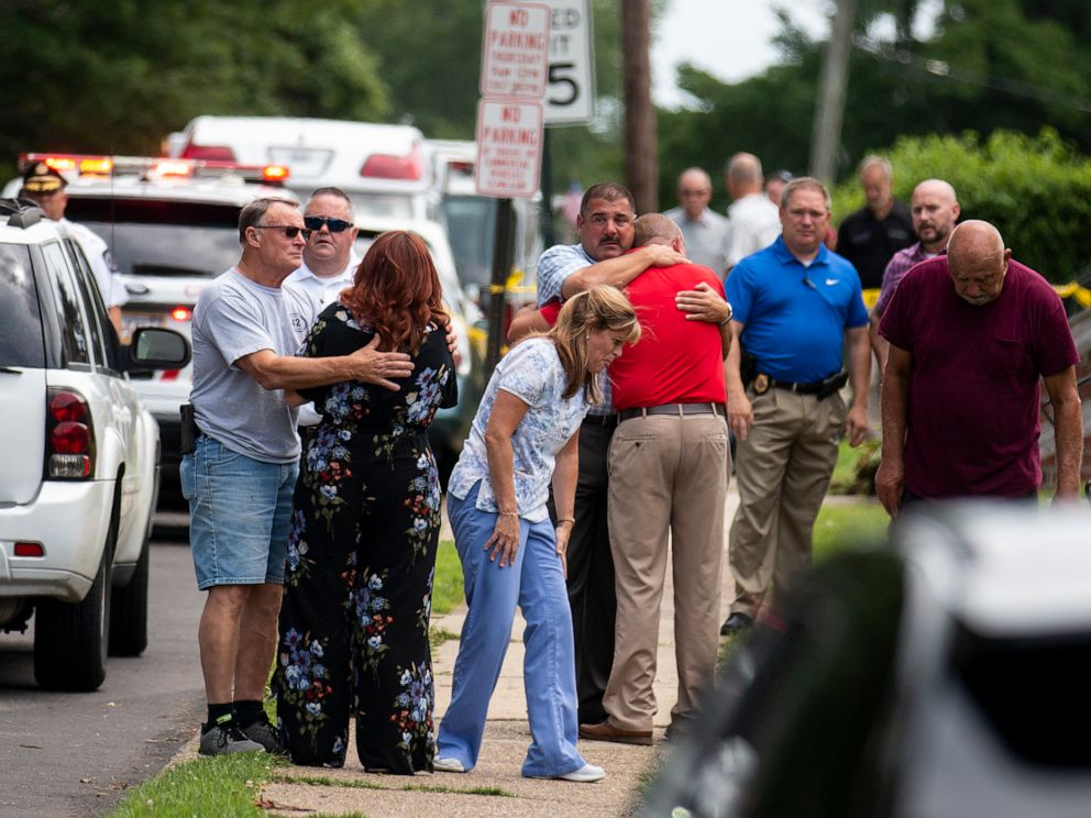 PHOTO: Community members and family console one another after two workers were found dead in a sewer manhole in Alden, Pa., July 11, 2019.