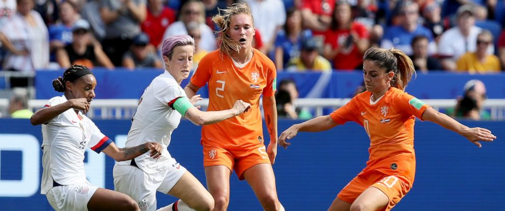 PHOTO: Crystal Dunn and Megan Rapinoe, center left, fights for the ball with Netherlands Desiree Van Lunteren, and Netherlands Danielle Van De Donk during the Womens World Cup final soccer match in Decines, outside Lyon, France, July 7, 2019.