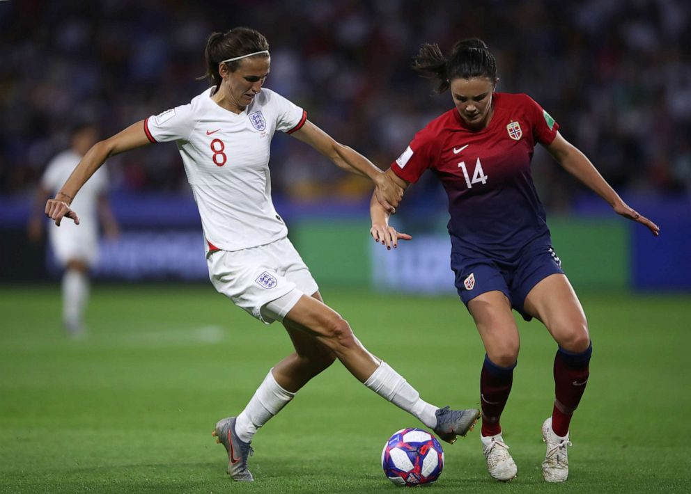 PHOTO: Jill Scott of England is challenged by Ingrid Syrstad Engen of Norway during the 2019 FIFA Womens World Cup France Quarter Final match between Norway and England at Stade Oceane on June 27, 2019, in Le Havre, France.