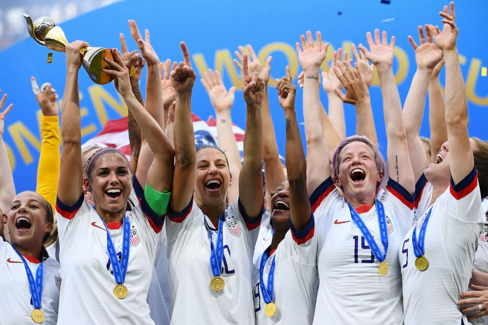 PHOTO: U.S. players celebrate with the trophy after the France 2019 Womens World Cup football final match between USA and the Netherlands, on July 7, 2019, at the Lyon Stadium in Lyon, central-eastern France.