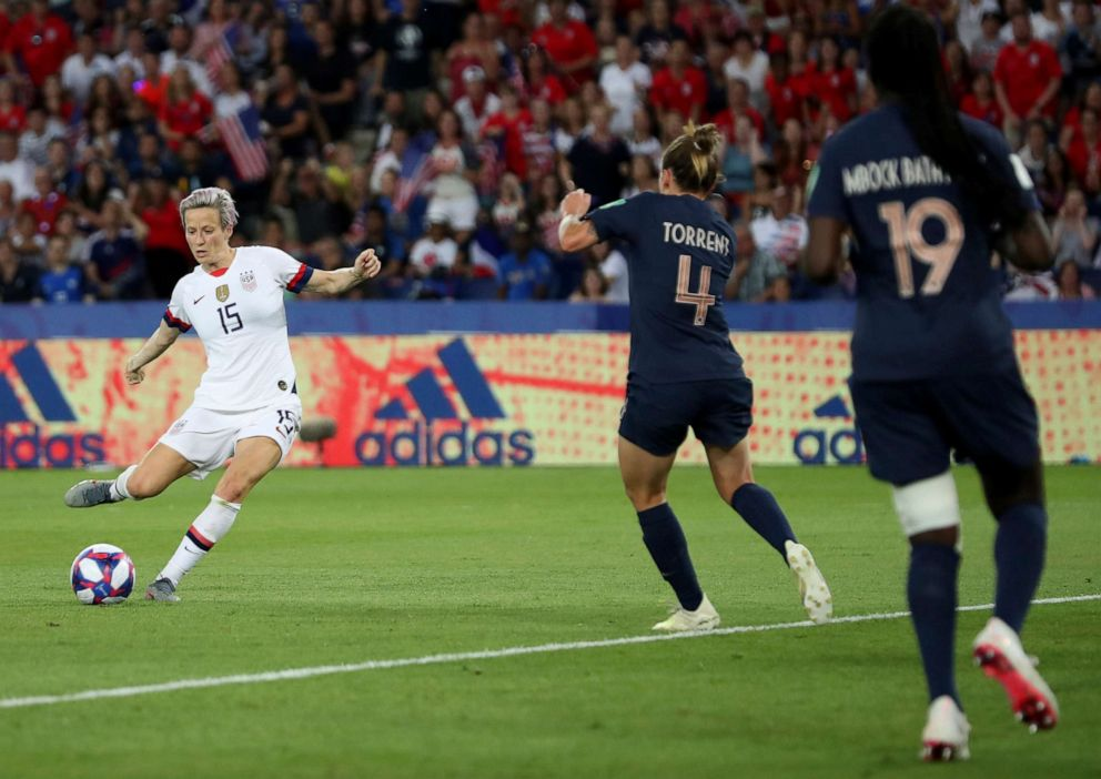 PHOTO: United States Megan Rapinoe, right, on her way to scoring her sides second goal during the Womens World Cup quarterfinal soccer match between France and the United States at the Parc des Princes, in Paris, June 28, 2019.