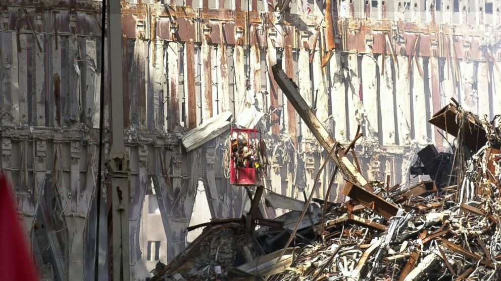 Workers at Ground Zero are suspended over a mountain of rubble as they dismantle the skeletal remains of Tower 2, all that still stands after the Sept. 11 terrorist attack on the World Trade Center, Sept. 27, 2001, in New York.