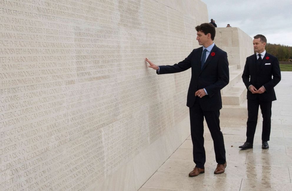 PHOTO: Canadas Minister of Veterans Affairs Seamus ORegan looks on as Canadian Prime Minister Justin Trudeau touches the names of fallen soldiers engraved in the Canadian National Vimy Memorial, Nov. 10, 2018, at Vimy Ridge, in France.