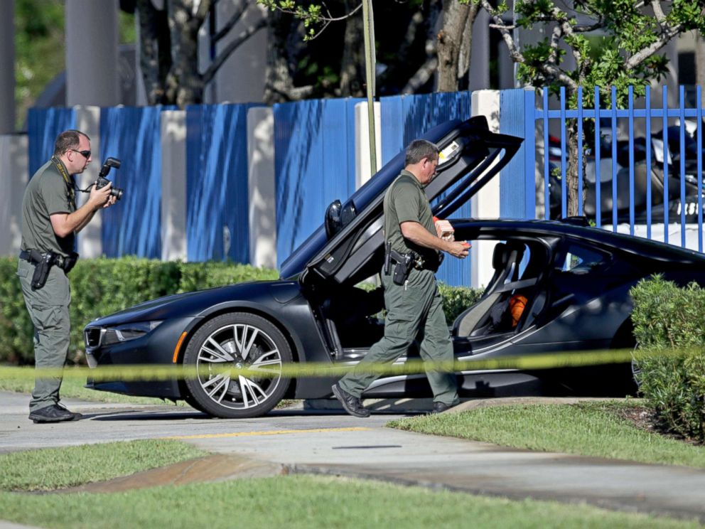 PHOTO: Investigators surround a vehicle after rapper XXXTentacion was shot, June 18, 2018, in Deerfield Beach, Fla.
