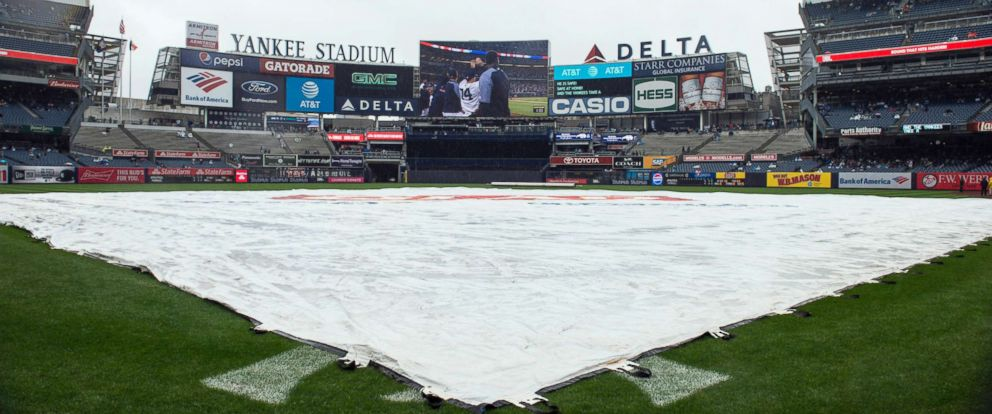 PHOTO: Rain delay for the game between the Oakland Athletics vs the New York Yankees at Yankee Stadium, May 13, 2018, in the Bronx, New York.