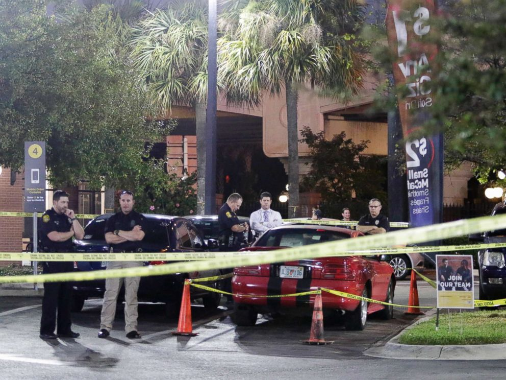 PHOTO: Officers are processing possible evidence and a red sports car at a McDonalds in Ybor City in Tampa, Fla, Nov. 28, 2017.