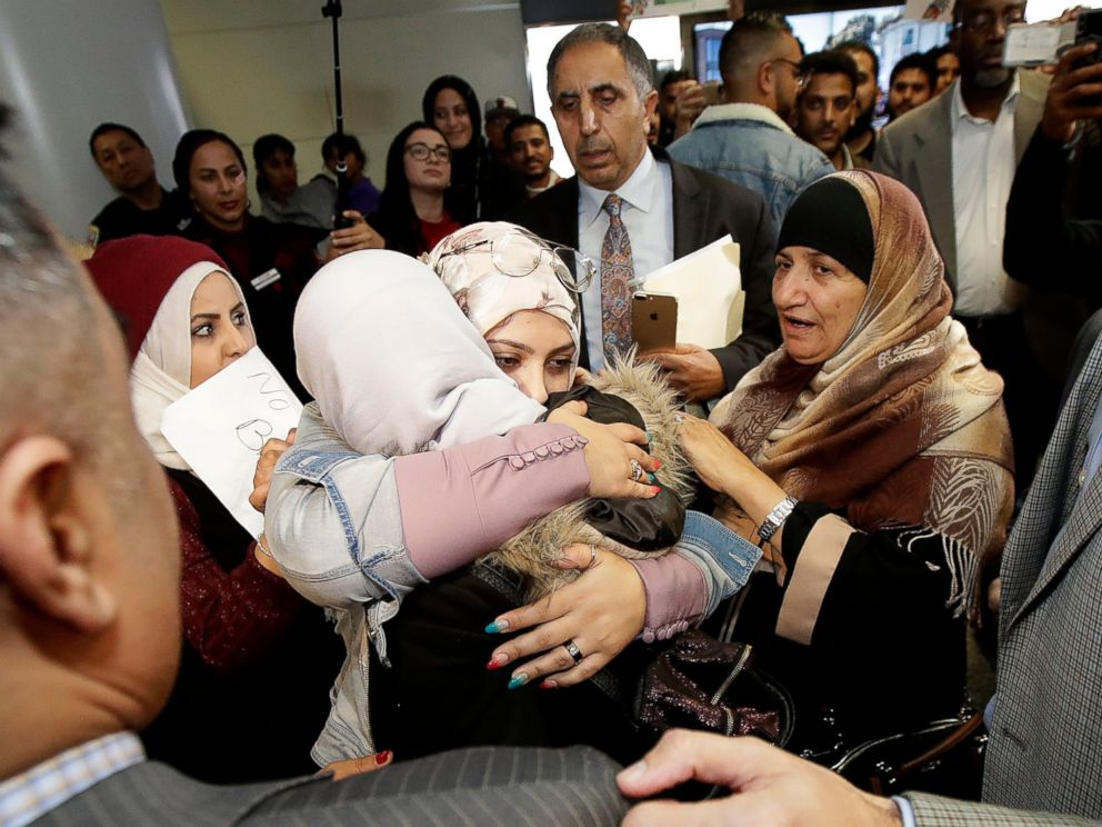 PHOTO: Shaima Swileh, center with her back turned, is greeted by supporters after arriving at San Francisco International Airport in San Francisco, Wednesday, Dec. 19, 2018.