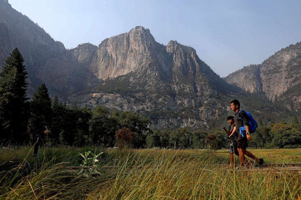 PHOTO: Guests make their way past Columbia Rock in Cooks Meadow as Yosemite Valley reopens in Yosemite, Calif., on Aug. 14, 2018.