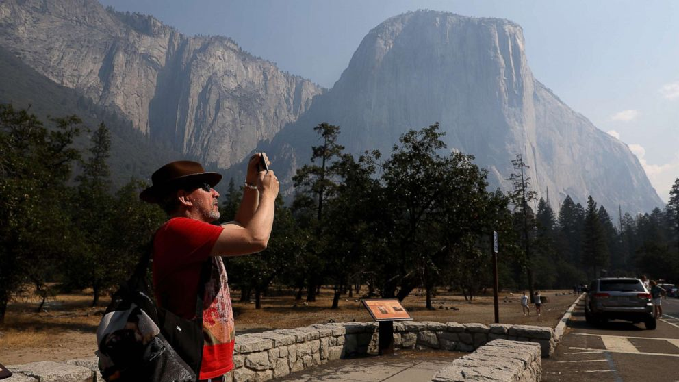 YOSEMITE VALLEY  CA AUGUST 14, 2018 -- Steve Maddison takes pictures near El Capitan in the Yosemite Valley, Aug. 14, 2018, after it reopened since being closed due to the Ferguson fire.
