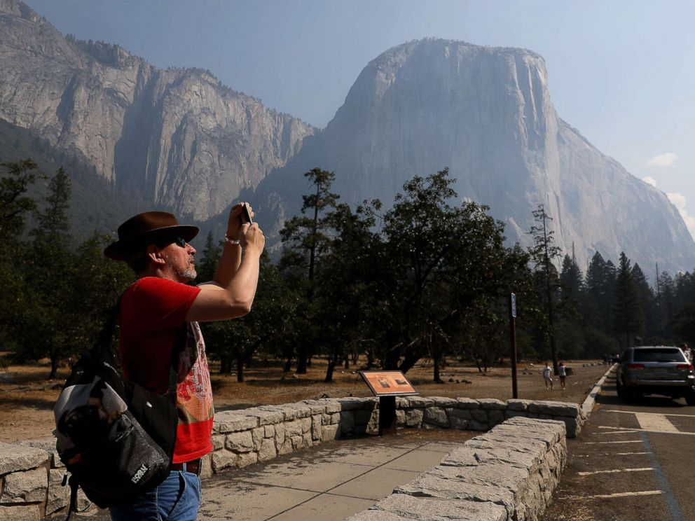PHOTO: YOSEMITE VALLEY CA AUGUST 14, 2018 -- Steve Maddison takes pictures near El Capitan in the Yosemite Valley, Aug. 14, 2018, after it reopened since being closed due to the Ferguson fire.