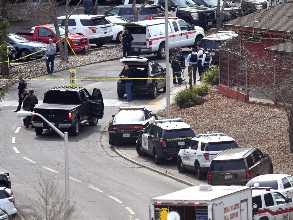 PHOTO: Law enforcement personnel gather near the scene where an active shooter has taken hostages at the Veteran Administration Hospital in Yountville, Calif., March 9, 2018.