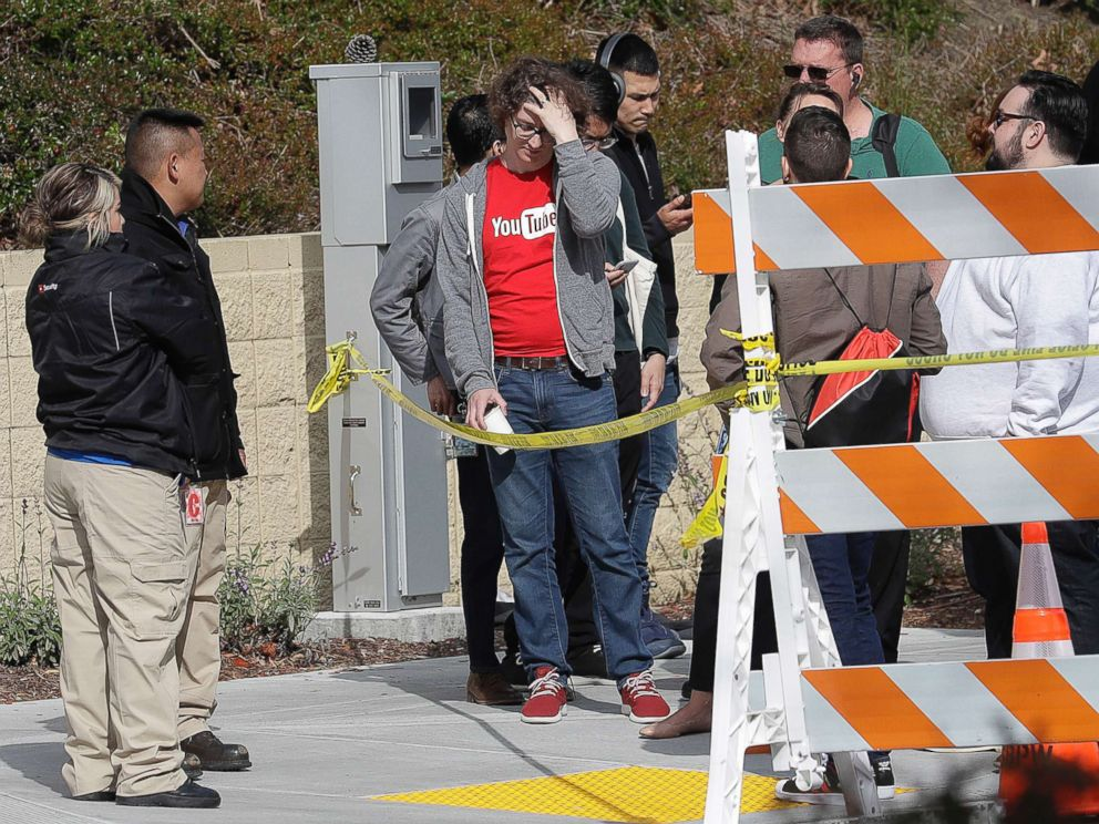 PHOTO: People wait to be escorted into a YouTube office building in San Bruno, Calif., April 4, 2018.