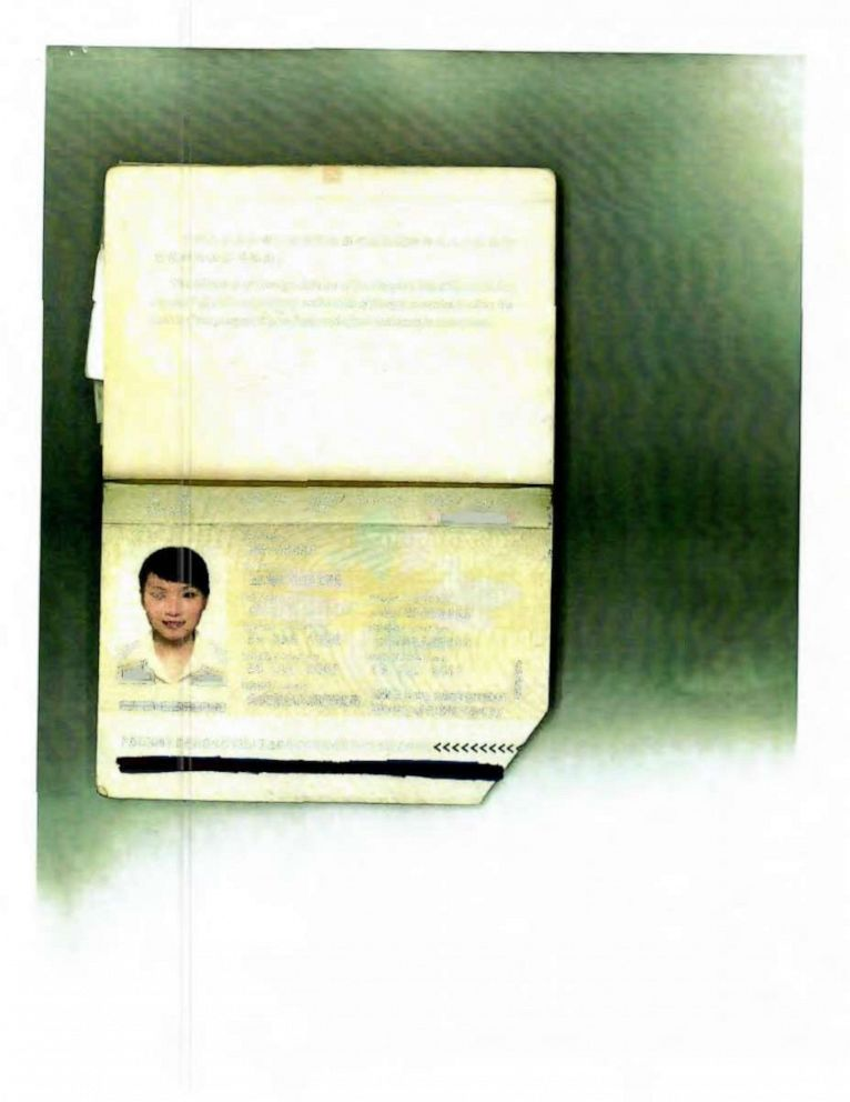 PHOTO: A passport photo of Yujing Zhang, alleged Mar-a-Lago intruder, was entered into evidence during a pre-trial hearing in Florida.