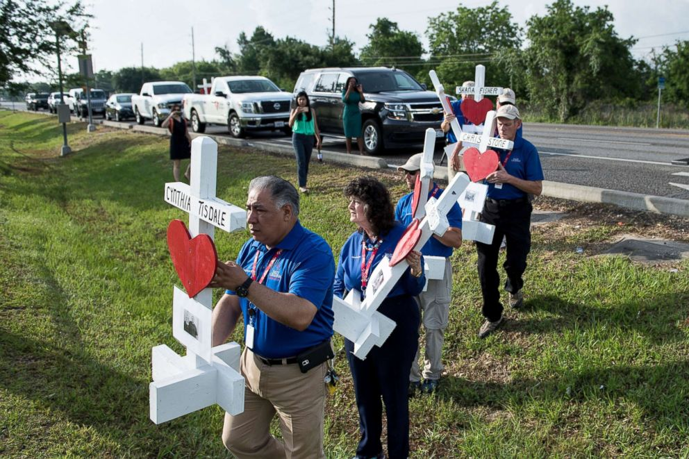 PHOTO: People carry crosses made by Greg Zanis for the victims of the Santa Fe High School, May 21, 2018, in Santa Fe, Texas.
