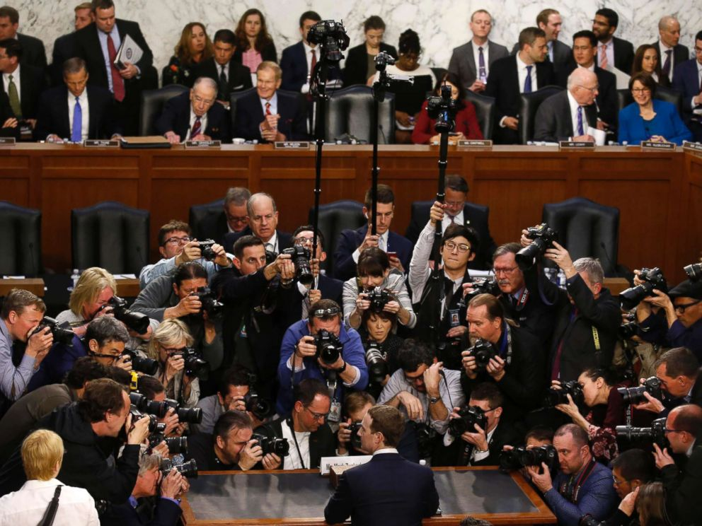 Facebook CEO Mark Zuckerberg is surrounded by members of the media during his appearance before a Senate Judiciary and Commerce Committees joint hearing on Capitol Hill in Washington, April 10, 2018.