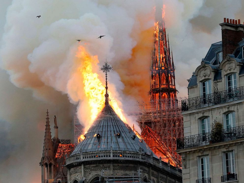 PHOTO: Smoke and flames rise during a fire at the Notre-Dame Cathedral in central Paris on April 15, 2019.