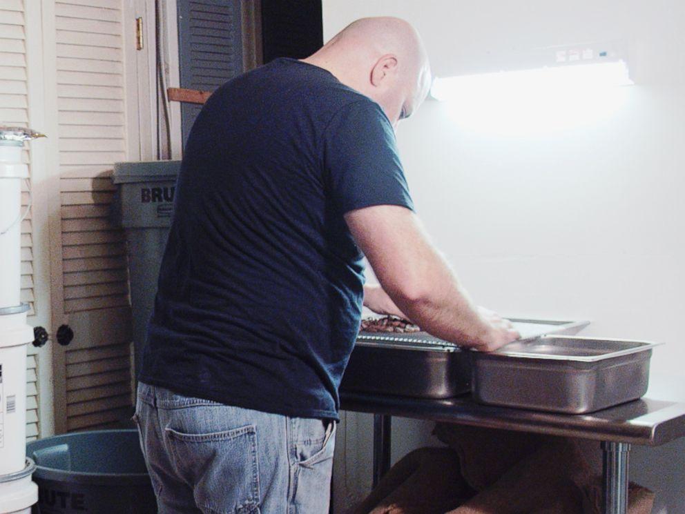 PHOTO: Ben Rasmussen sorting through cocoa beans in his Woodbridge, Virginia basement.