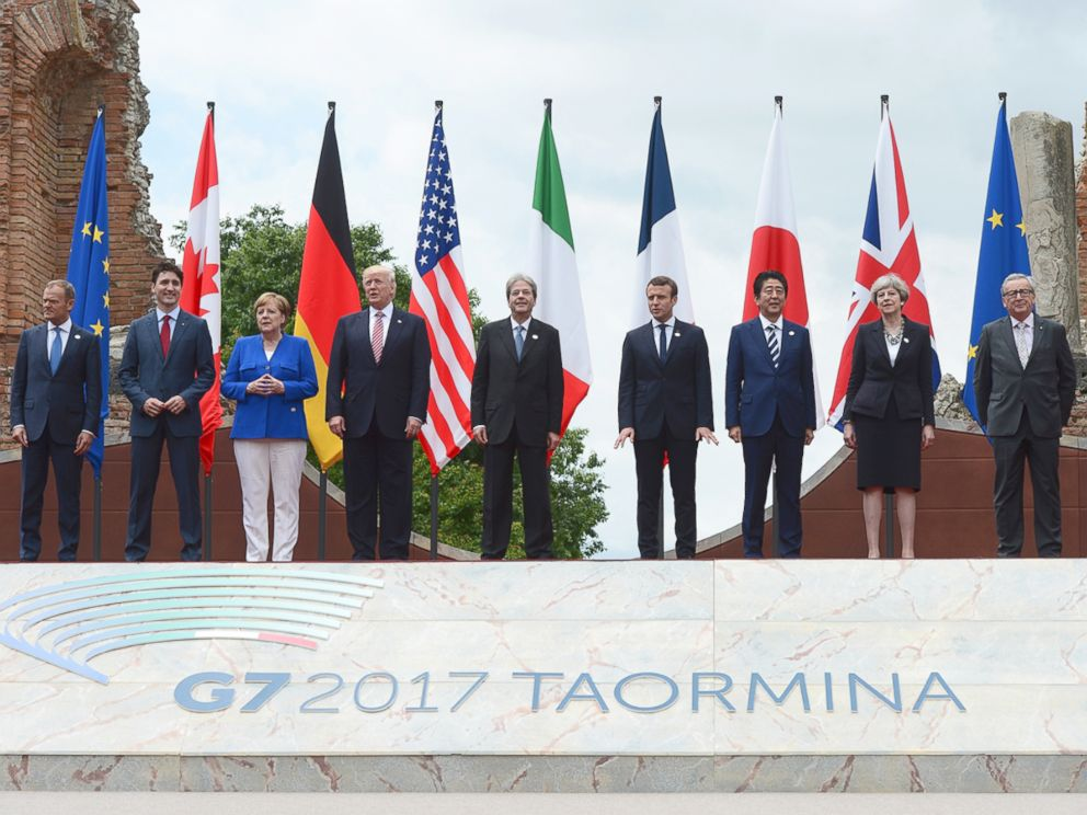 PHOTO: G7 leaders, pose for a family photo at the Ancient Greek Theater of Taormina, on May 26, 2017, in Taormina, Italy.