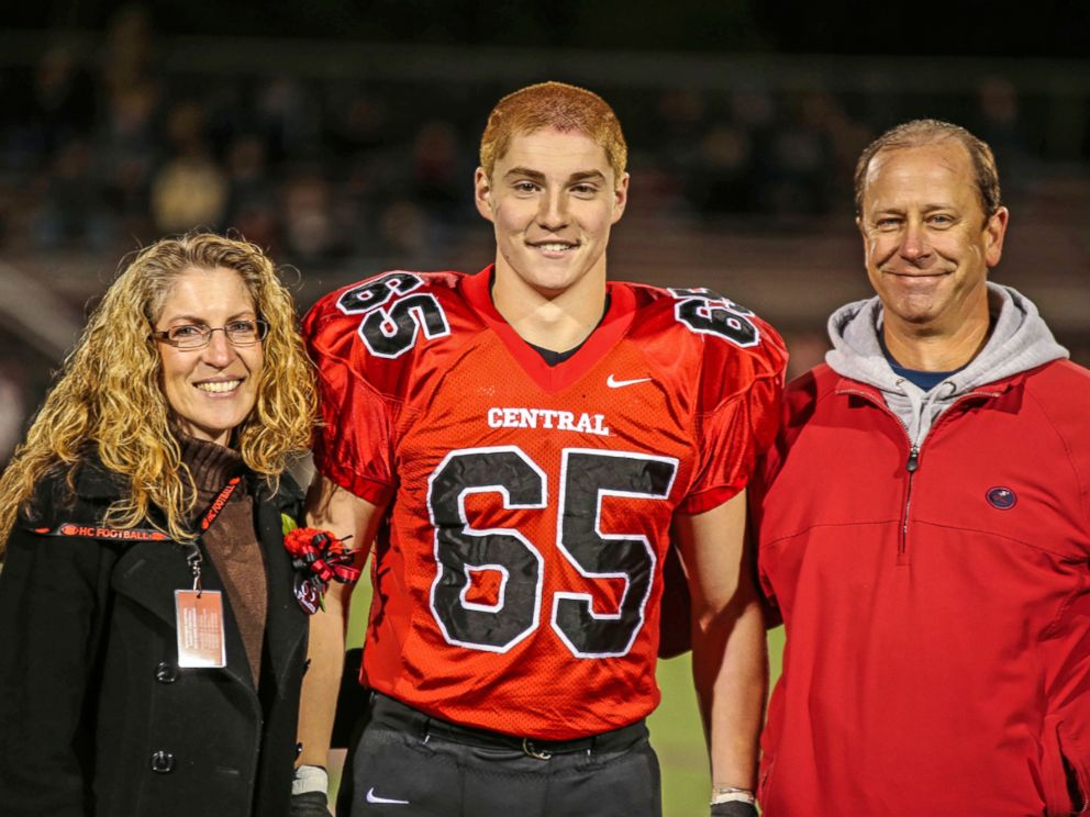 PHOTO: This Oct. 31, 2014, photo provided by Patrick Carns shows Timothy Piazza, center, with his parents Evelyn Piazza and James Piazza, during Hunterdon Central Regional High School footballs Senior Night, in Flemington, N.J.