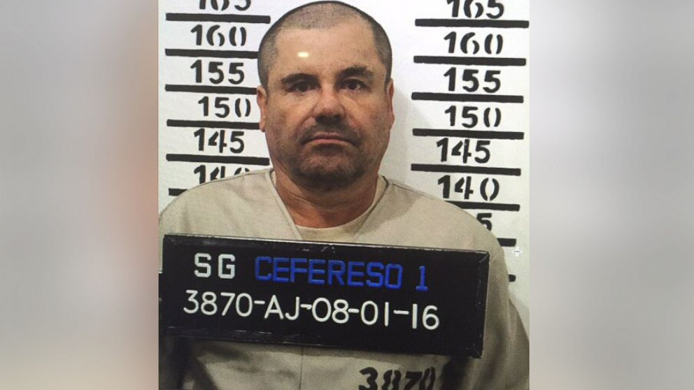 """IMexico's most wanted drug lord, Joaquin """"El Chapo"""" Guzman, stands for his prison mug shot with the inmate number 3870 at the Altiplano maximum security federal prison in Almoloya, Mexico,  Jan. 8, 2016."""