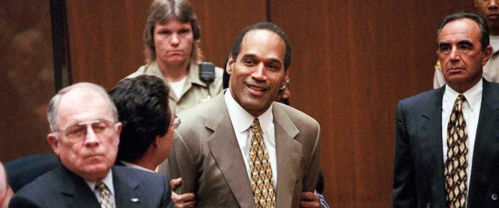PHOTO: In this Oct. 3, 1995, file photo, O.J. Simpson, center, clenches his fists in victory after the jury said he was not guilty in the murders of his ex-wife Nicole Brown Simpson and her friend Ronald Goldman.