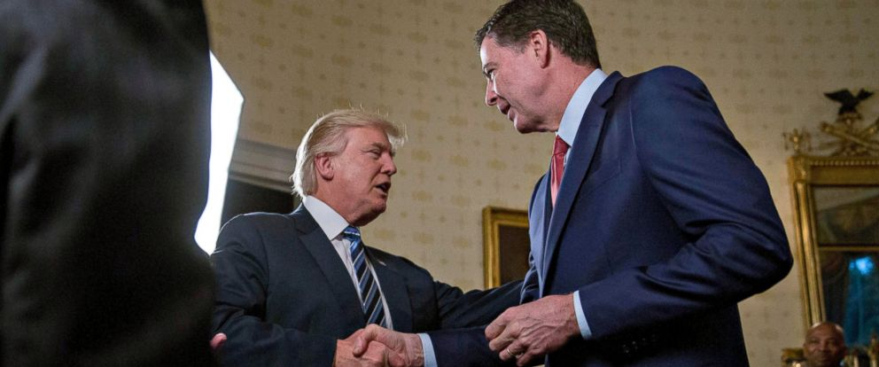 PHOTO: President Donald Trump shakes hands with James Comey, director of the Federal Bureau of Investigation (FBI), during an Inaugural Law Enforcement Officers and First Responders Reception in the Blue Room of the White House, Jan. 22, 2017.