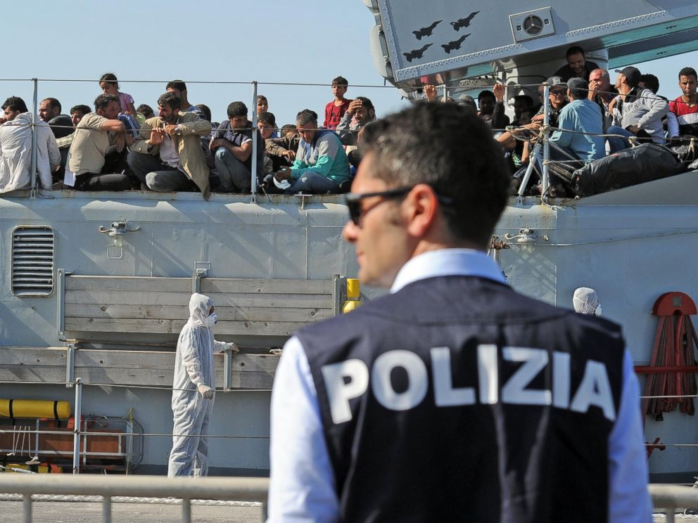 PHOTO: A policeman waits near the Italian military ship Chimera, with around 350 would be immigrants on board
