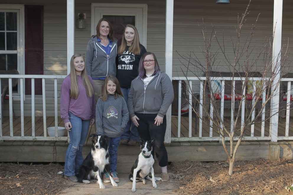 PHOTO: Rebecca Gibson trains dogs at her home in Stanfield, North Carolina, with the help of her four daughters.