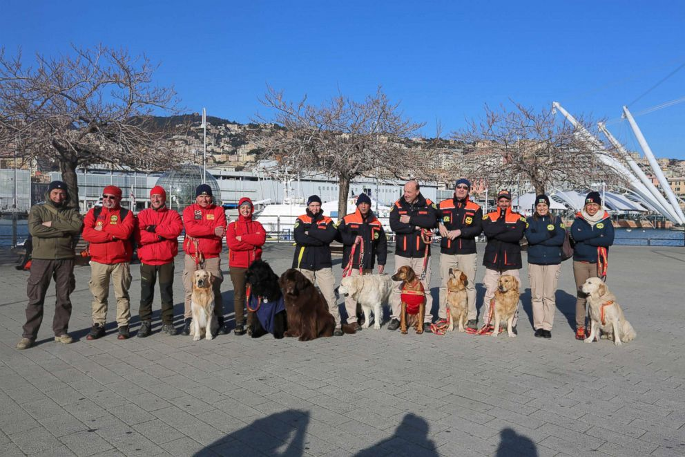 PHOTO: Handlers and their dogs pose after completing their rescue exercise in Genoa, Italy