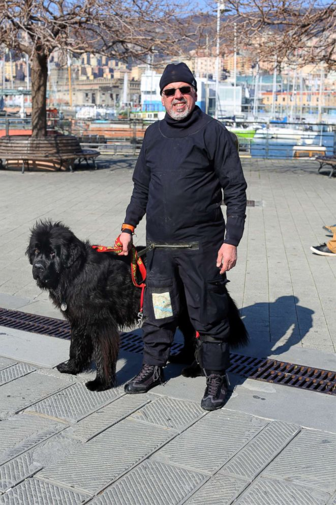 PHOTO: Ferruccio Pilenga stands with his water rescue dog, Reef, a Newfoundland, in Genoa, Italy.
