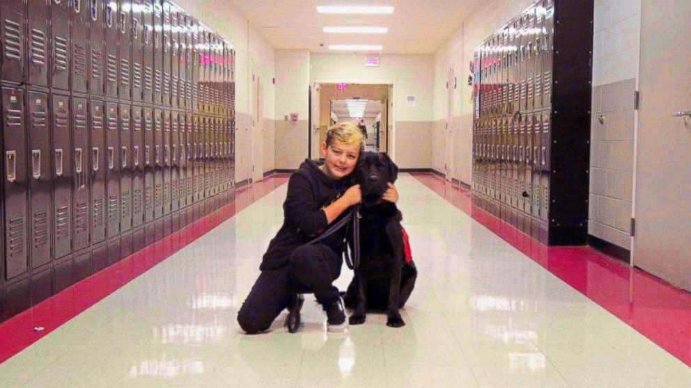 PHOTO: Eli Nichols takes his medical service dog, Einstein, to school with him every day in Arlington, Tenn.