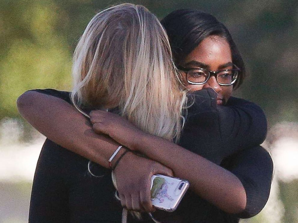 PHOTO: Two people embrace as they arrive before a funeral service for Alyssa Alhadeff at the Star of David Funeral Chapel in North Lauderdale, Fla., Feb. 16, 2018.