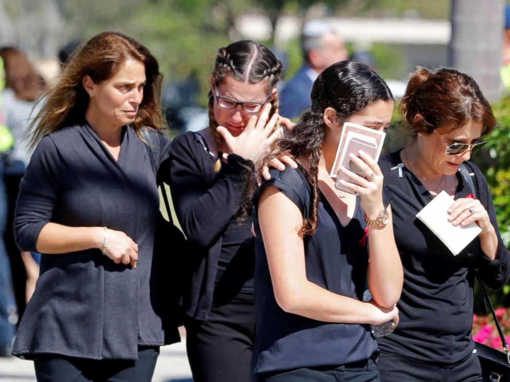 PHOTO: Mourners leave the funeral for Alyssa Aldaheff, 14, one of the victims of the school shooting, in North Fort Lauderdale, Fla., Feb. 16, 2018.