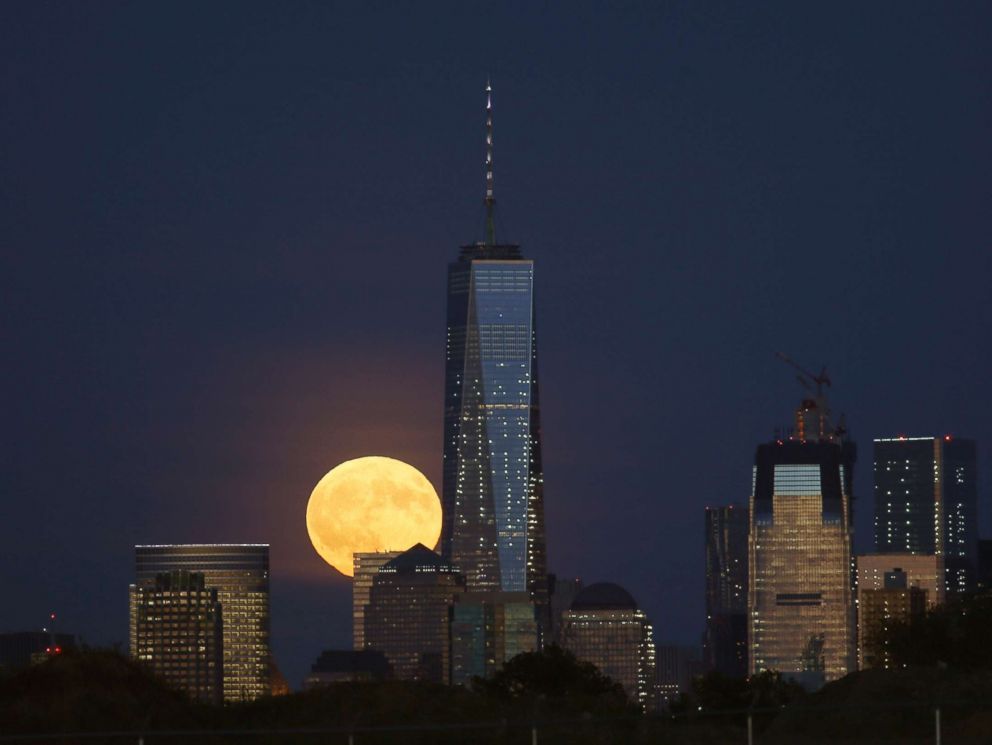 PHOTO: A full harvest moon rises behind Lower Manhattan and One World Trade Center in New York City, Sept. 16, 2016 as seen from Newark, N.J.
