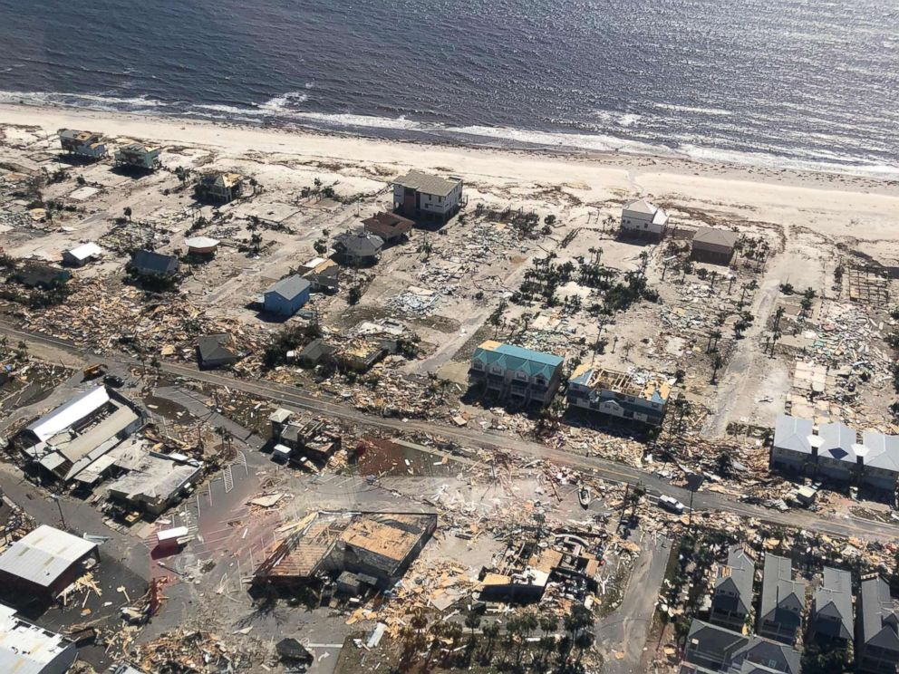 PHOTO: A U.S. Customs and Border Protection helicopter surveys the damage wrought by Hurricane Michael over Mexico Beach, Fla., on Oct. 11, 2018.