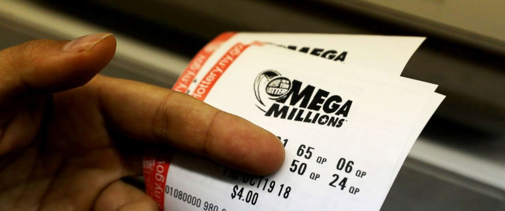 PHOTO: A customer holds Mega Millions tickets at a newsstand in midtown Manhattan in N.Y., Oct. 9, 2018.